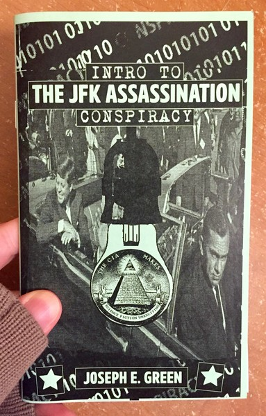 Cover of Intro to the JFK Assassination Conspiracy which features A green and black background with binary code spanning the background, President John F. Kennedy sits in the back of the car at the Dallas parade. A light hangs down, illuminating the Illuminati pyramid and eye.