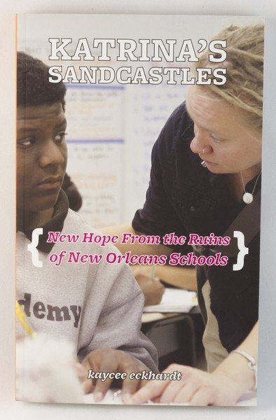 A book cover with a photo of a teacher mentoring a student
