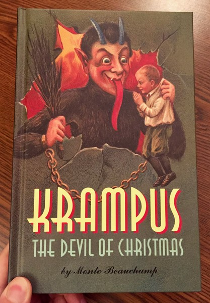 Krampus: The Devil of Christmas by Monte Beauchamp [Krampus gleefully examines a clean-cut child]