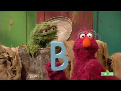 sesame street characters holding a big letter B