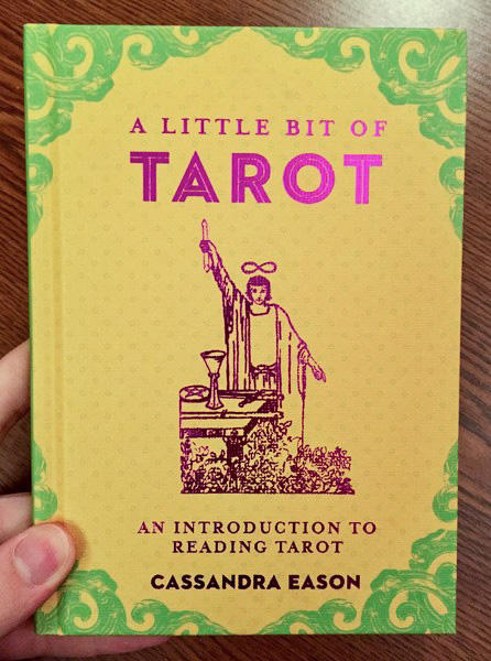 Cover of A Little Bit of Tarot: An Introduction to Reading Tarot which features the Rider-Waite version of the magician on a yellow background