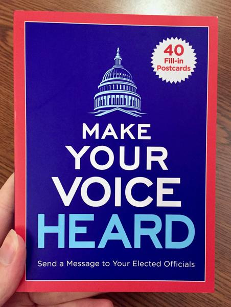 the cover of Make Your Voice Heard Postcard Book: Send a Message to Your Elected Officials [it features a white sketch of the capital dome over the title on a blue background with a red border]