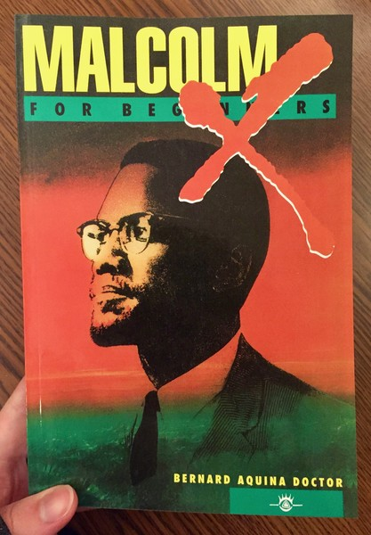 red background depicting Malcom X with a bright red X on right top of his head