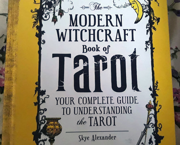 Cover of Modern Witchcraft Book of Tarot: Your Complete Guide to Understanding the Tarot, which features greenery and a chalice in a border around the title. The cover is slightly cut off on the top and bottom, though the words are all legible.