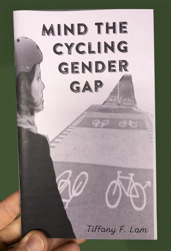 Cover of Mind the Gender Cycling Gap - a woman with a helmet on looks out over a bike lane
