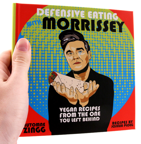 Morrissey holds (what I assume is) a vegan burrito out in front as a single tear falls from his eye