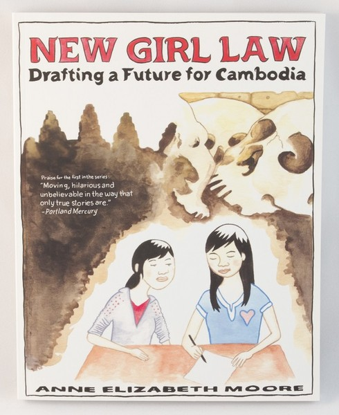 Book cover with an illustration of two girls writing at a table, surrounded by brown water colors and skulls