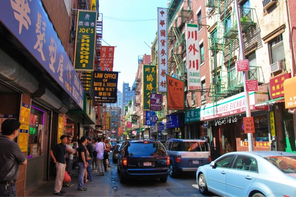 a photo of a crowded street in Chinatown, New York City