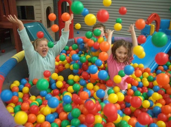 a picture of happy people in a ball pit!
