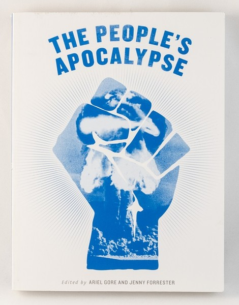 A white book with an image of a blue fist and a mushroom cloud within