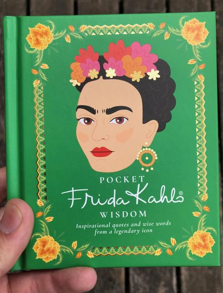 Green background with a yellow border, at the center is an illustration of Frida Kahlo.
