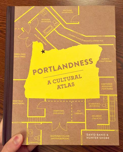 A brown and yellow book cover with a map motif and the State of Oregon outlined in the center