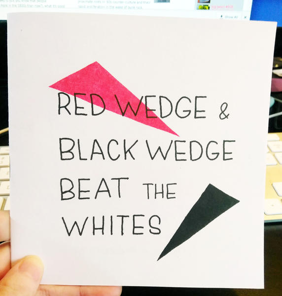 Cover of Red Wedge and Black Wedge Beat the Whites which features a red and black triangle.