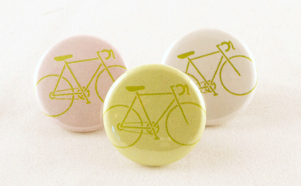 buttons with a road bike image