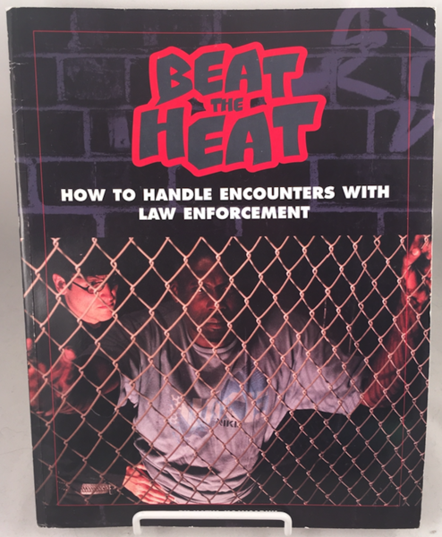 book cover showing a guy getting arrestedbehind metal chain bars