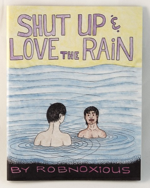 A zine with a drawing of two people in a large body of water with a yellow sky