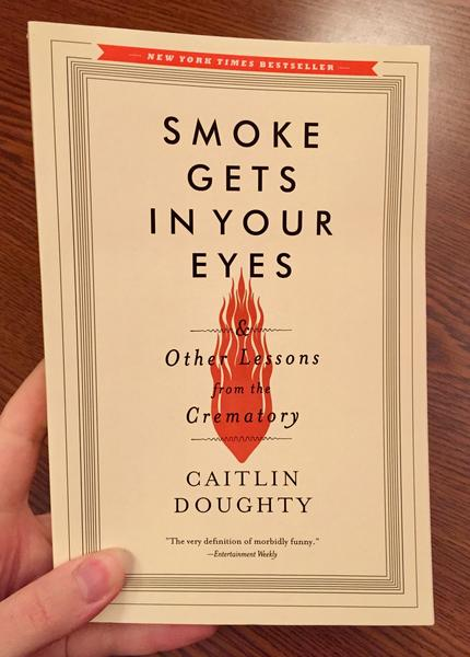 Cover of Smoke Gets in Your Eyes: And Other Lessons from the Crematory which features the title over an orange flame