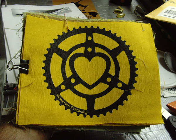 microcosm logo of chainring heart on patch