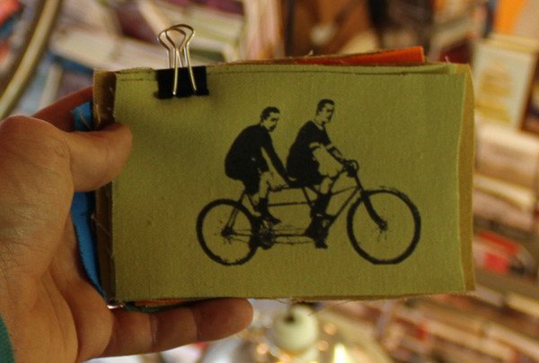 patch with image of two men riding tandem bicycle