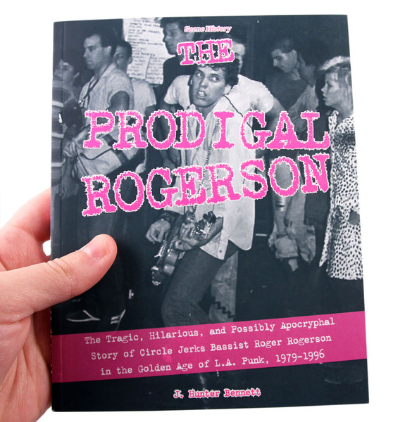 Prodigal Rogerson book cover: A punkish looking fellow plays guitar but appears to be thinking about something else entirely