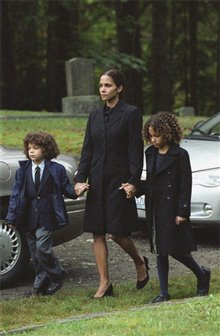 still image of a woman and two children at a funeral from the movie Things We Lost in the Fire