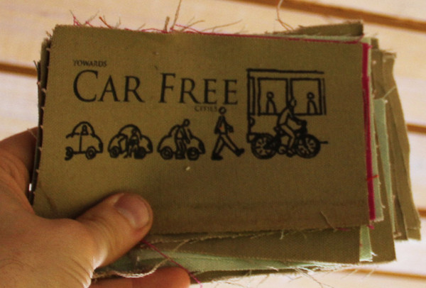 "patch with image of cars and bicycles and text: ""toward car free cities"""