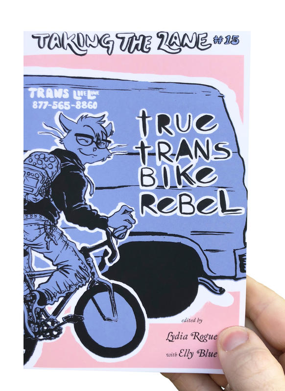 a cat on a bicycle spray painting the zine title on the side of a van
