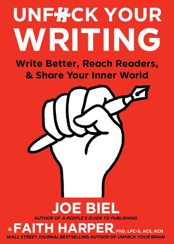 a raised fist clutches a pen