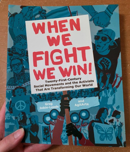 When We Fight We Win by Greg Jobin-Leeds and AgitArte [A resistance sign firmly clutched against a background of protesters]