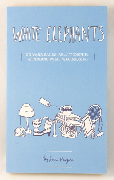 A light blue book cover with illustrations of a small, white elephant, a lamp, a tennis racket, some books, a shoe, and a mug blowup