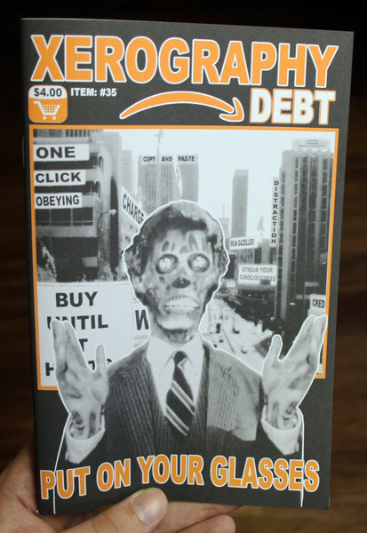 "Xerography Debt #35 cover featuring a zombie and the words ""put on your glasses"""