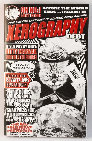 A fancy-looking, future-predicting cat looks over a globe on this zine cover. It looks reminiscent of the national enquirer and publications of the like blowup
