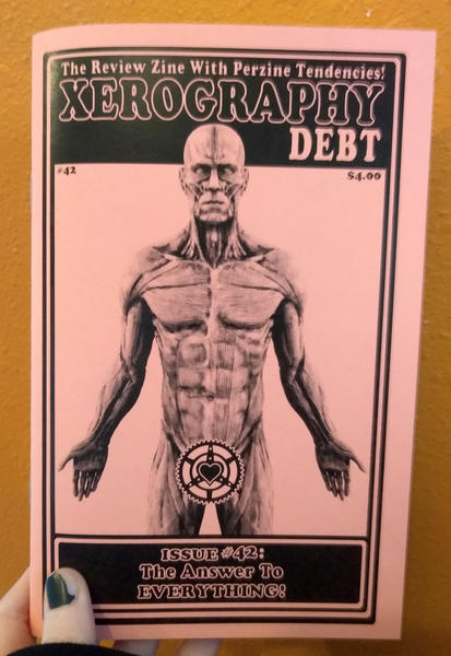 Cover of Zerography Debt #42 which features a man with no skin